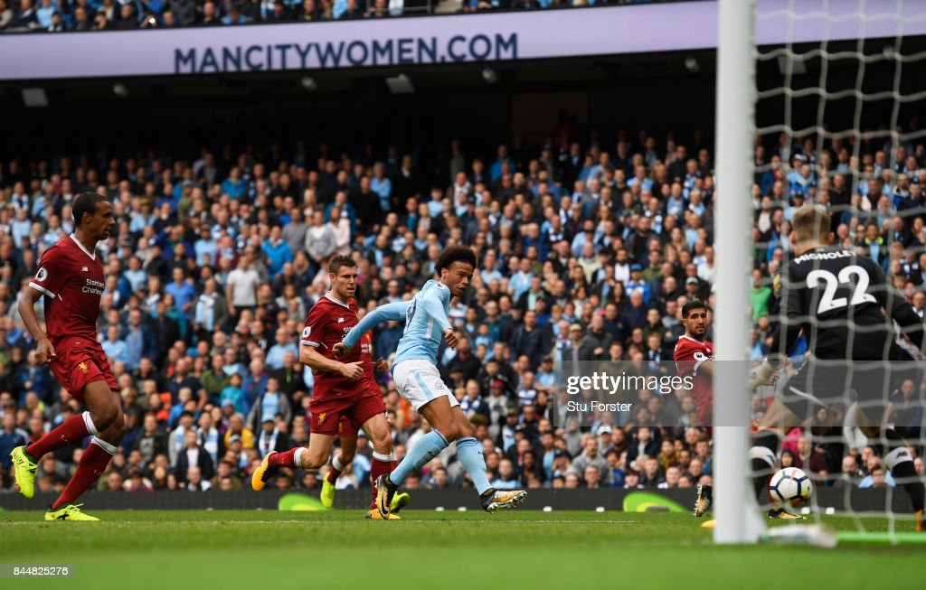 Leroy Sane of Manchester City scores his sides fourth goal past Simon Mignolet of Liverpool during the Premier League match between Manchester City and Liverpool at Etihad Stadium on September 9, 2017 in Manchester, England.
