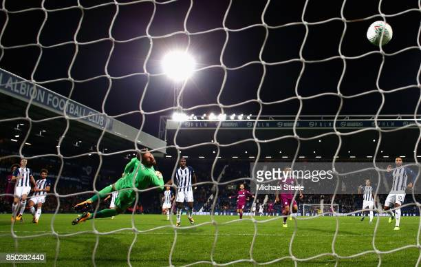 Leroy Sane of Manchester City scores his sides second goal past Ben Foster of West Bromwich Albion during the Carabao Cup Third Round match between...