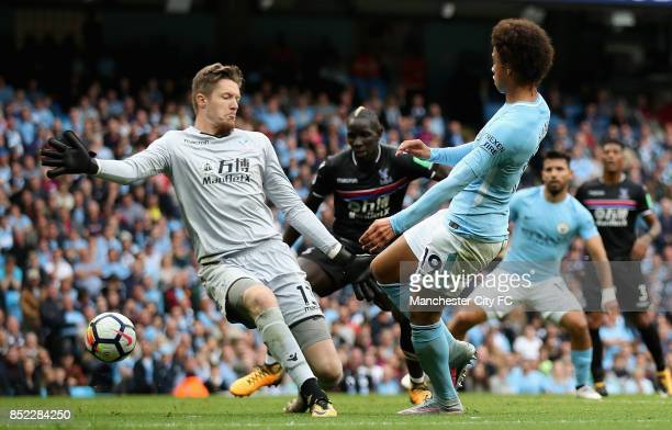 Leroy Sane of Manchester City scores his sides second goal past Wayne Hennessey of Crystal Palace during the Premier League match between Manchester...