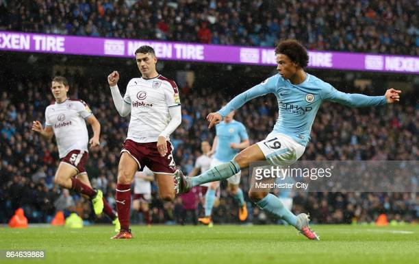 Leroy Sane of Manchester City scores his side's third goal during the Premier League match between Manchester City and Burnley at Etihad Stadium on...