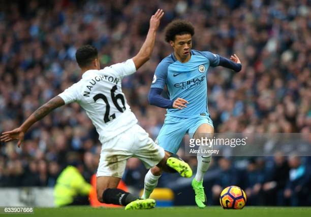 Leroy Sane of Manchester City takes on Kyle Naughton of Swansea City during the Premier League match between Manchester City and Swansea City at...