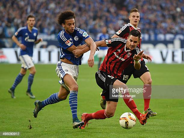 Leroy Sane of Schalke and Benjamin Huebner of Ingolstadt compete for the ball during the Bundesliga match between FC Schalke 04 and FC Ingolstadt at...