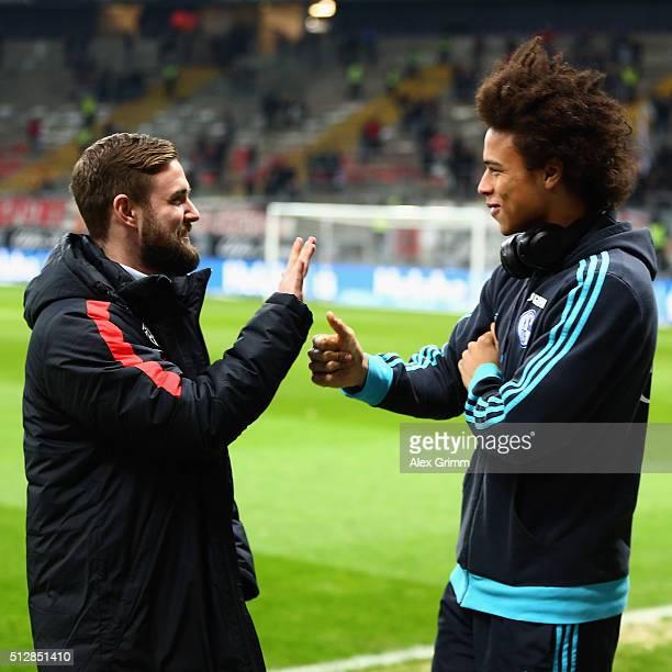 Leroy Sane of Schalke and Marc Stendera of Frankfurt chat prior to the Bundesliga match between Eintracht Frankfurt and FC Schalke 04 at...