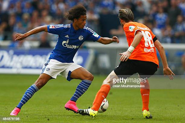 Leroy Sane of Schalke battles for the ball with Peter Niemeyer of Darmstadt during the Bundesliga match between FC Schalke 04 and SV Darmstadt 98...