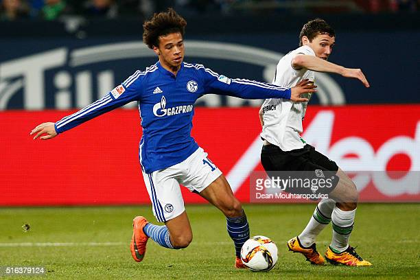 Leroy Sane of Schalke beats Andreas Christensen of Borussia Monchengladbach during the Bundesliga match between FC Schalke 04 and Borussia...