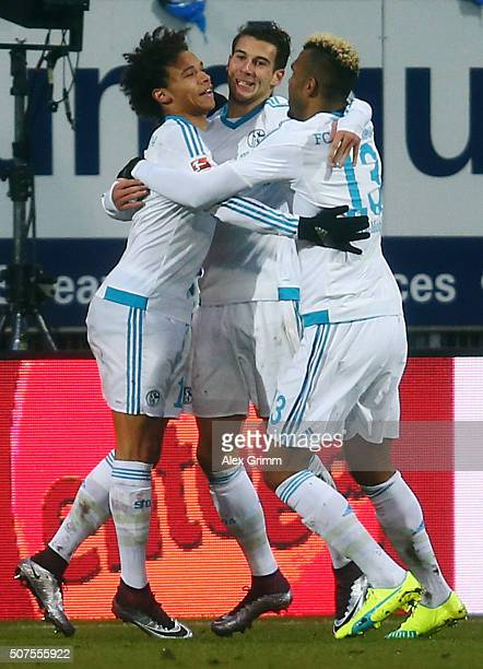 Leroy Sane of Schalke celebrates his team's second goal with team mates Leon Goretzka and Eric Maxim ChoupoMoting during the Bundesliga match between...