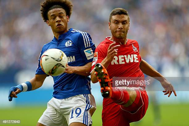 Leroy Sane of Schalke challenges Jonas Hector of Koeln during the Bundesliga match between FC Schalke 04 and 1 FC Koeln at VeltinsArena on October 4...