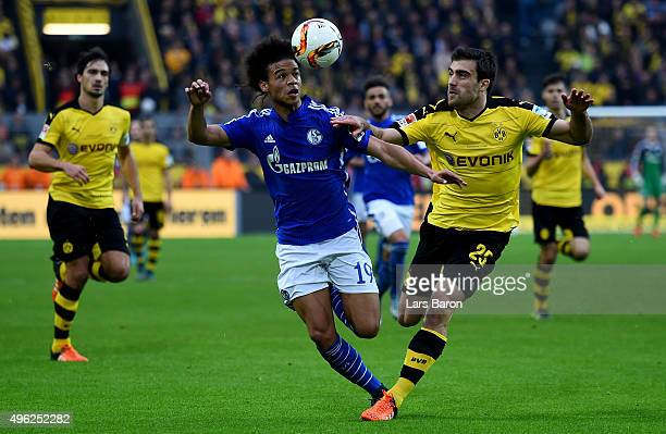 Leroy Sane of Schalke is challenged by Sokratis of Dortmund during the Bundesliga match between Borussia Dortmund and FC Schalke 04 at Signal Iduna...