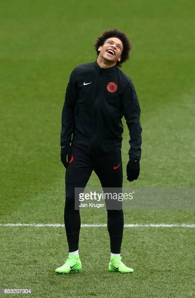 Leroy Sane smiles during a Manchester City training session prior to the UEFA Champions League Round of 16 Second Leg match against Monaco at Etihad...