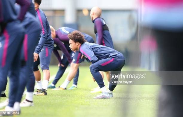 Leroy Sane stretching during training at Manchester City Football Academy on September 22 2017 in Manchester England