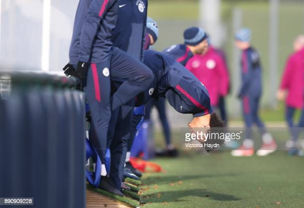 Leroy Sane stretching during training at Manchester City Football Academy on December 12 2017 in Manchester England