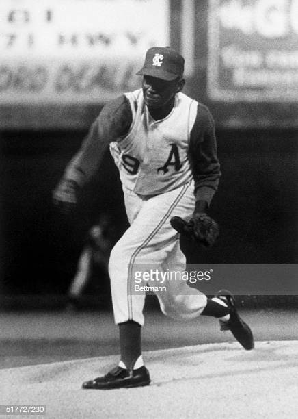 Leroy 'Satchel' Paige veteran of the Negro Leagues and various Major League and minor league teams pitches the baseball as the starting pitcher for...