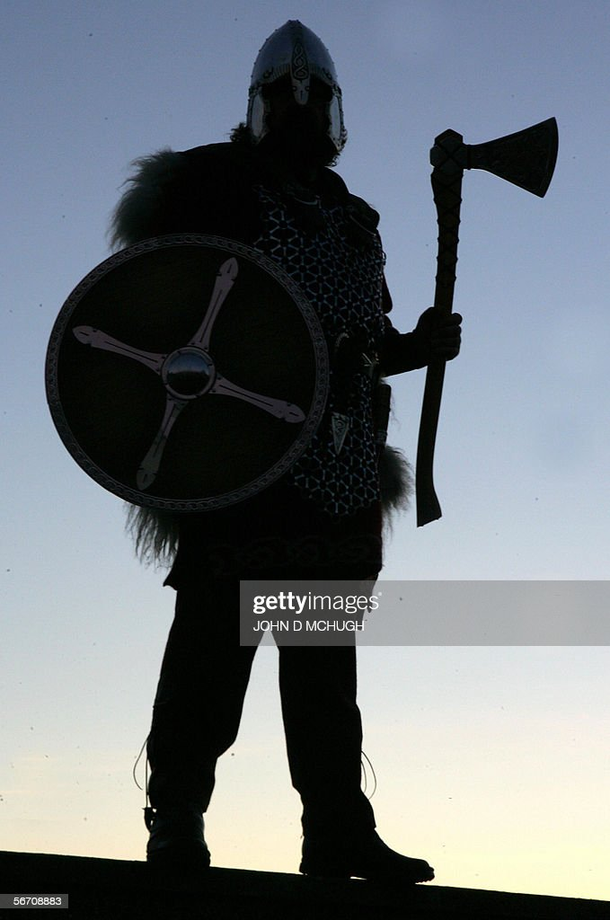 Shetlander Ivor Cluness leaves his house at dawn dressed as a Viking before parading through the streets of Lerwick on the Shetland Islands north of...