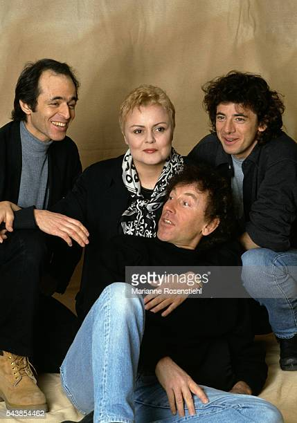 Les Enfoirés composed of French singer Patrick Bruel humorist Muriel Robin singers and songwriters JeanJacques Goldman and Alain Souchon support the...