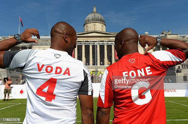 Les Ferdinand and Ian Wright pose for the camera during the Vodafone 4G Goes Live Launch at Trafalgar Sq on August 29 2013 in London England Vodafone...