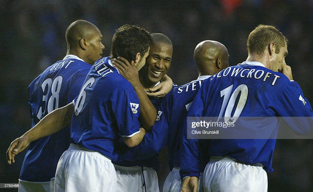 Les Ferdinand of Leicester celebrates scoring with his team mates during the FA Barclaycard Premiership match between Leicester City and Charlton Athletic at Walkers Stadium on Novermber 22, 2003 in Leicester, England.