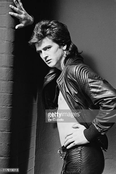 Les McKeown British pop singer poses barechested beneath a black leather jacket in a studio portrait March 1979 McKeown is formerly the lead singer...
