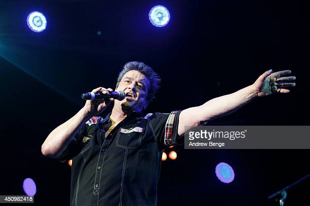 Les McKeown of Bay City Rollers performs on stage at Phones 4 U Arena on June 20 2014 in Manchester United Kingdom