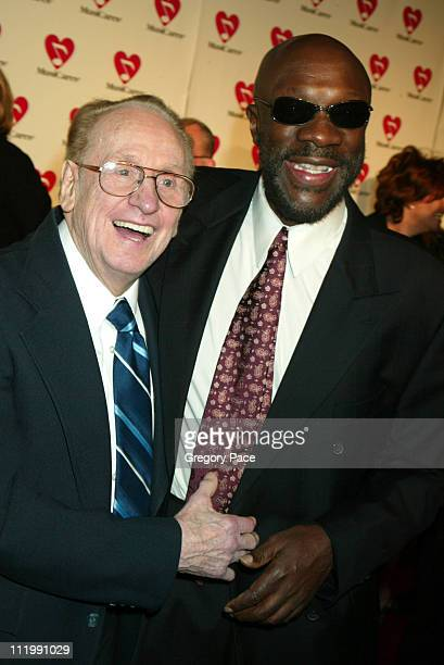Les Paul and Isaac Hayes during The 45th GRAMMY Awards MusiCares 2003 Person of the Year Bono Arrivals by Gregory Pace at Marriott Marquis in New...