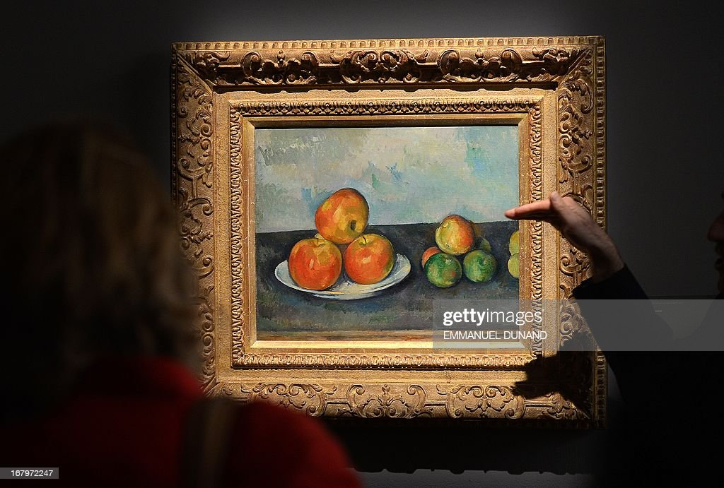 'Les Pommes' by Paul Cezanne is on display during a preview of Sotheby's Impressionist and Modern Art sales in New York on May 3, 2013. Sotheby's is scheduled to hold its Impressionist and Modern Art sales May 7. AFP PHOTO/Emmanuel Dunand ++RESTRICTED