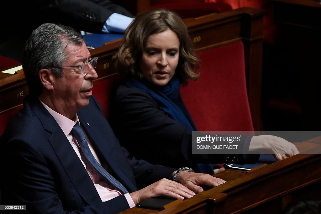 Les Republicains MPs Patrick Balkany (L) and Nathalie Kosciusko-Morizet take part in a debate prior to the vote on the reform of the 'Conseil superieur de la magistrature', on May 24, 2016 at the National Assembly in Paris.