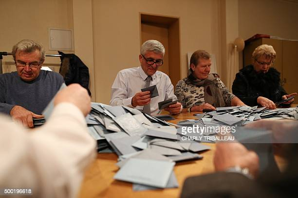 Les Republicains rightwing party top candidate for the regional elections in Normandie Herve Morin takes part in the votes' counting on the first...