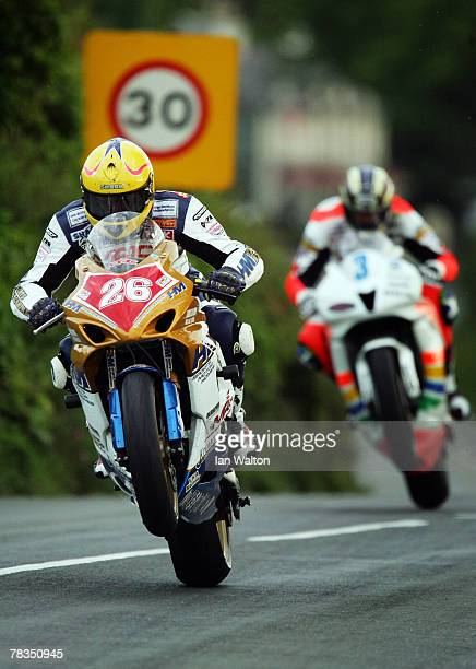 Les Shand and John McGinness in action as he exit's Kirk Michael during Practice of the Isle of Man TT Races on Jun 1 2007 in the Isle of Man