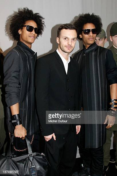 Les Twins and Kris Van Assche posing after the Dior Homme Menswear Autumn/Winter 2013 show as part of Paris Fashion Week on January 21 2012 in Paris...