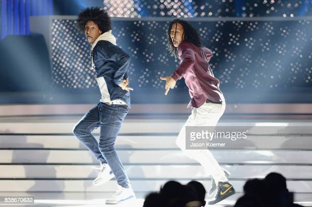 Les Twins perform on stage at Telemundo's 2017 'Premios Tu Mundo' at American Airlines Arena on August 24 2017 in Miami Florida