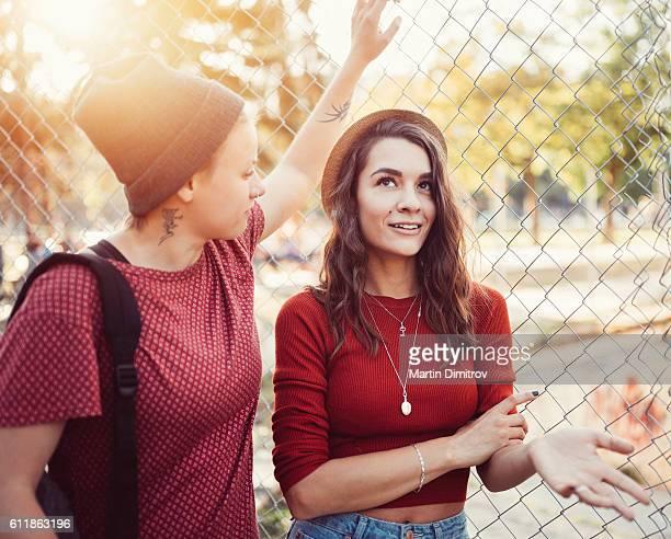 Lesbian couple flirting outside