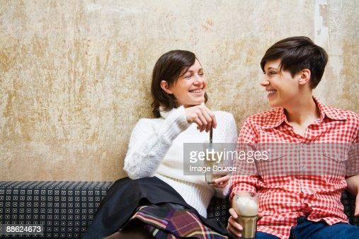 A lesbian couple having coffee