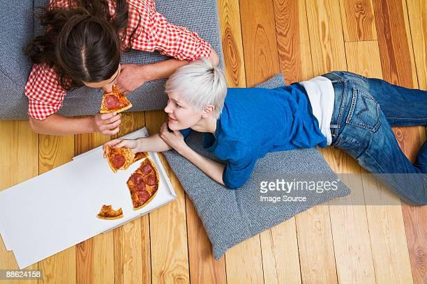 A lesbian couple having pizza