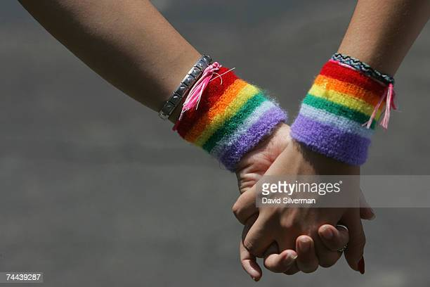 A lesbian couple hold hands during the annual Gay Pride rally on June 8 2007 Tel Aviv Israel's most cosmopolitan city Thousands of alternative...