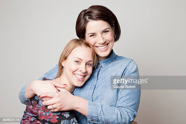 Lesbian couple hugging and smiling