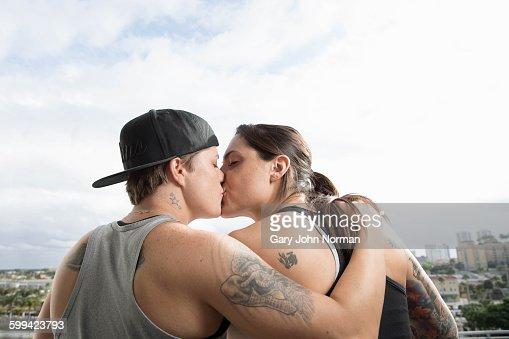 Lesbian couple kiss on balcony