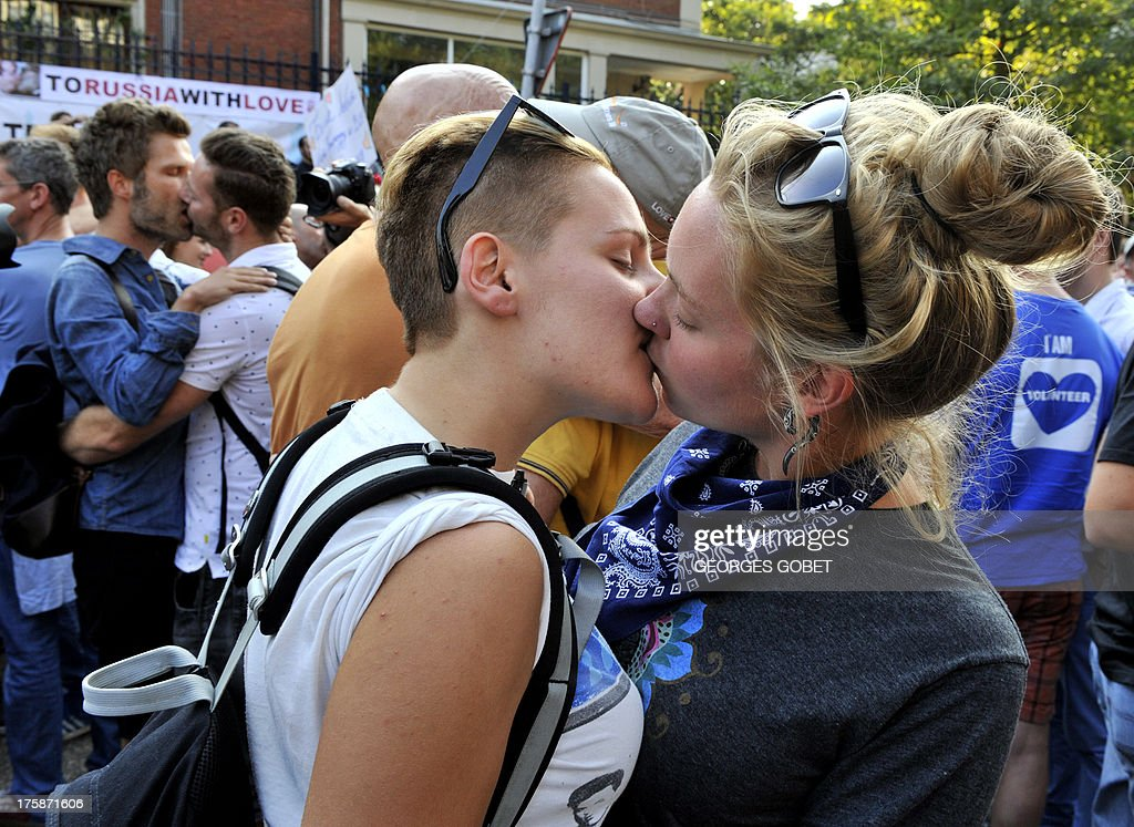 A lesbian couple kisses as they participate in a 'KissIn' action at the Russian consulate in Antwerp to protest against the treatment of lesbian gay...