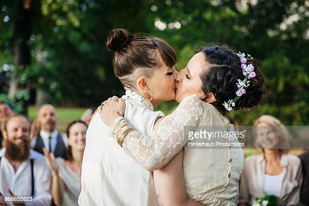 Lesbian couple kissing at their wedding ceremony