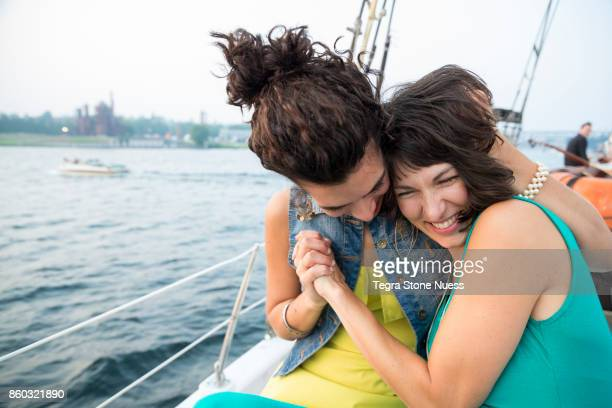 Lesbian Couple Laughing on Sailboat
