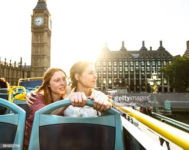 lesbian couple of tourist take a tour in London