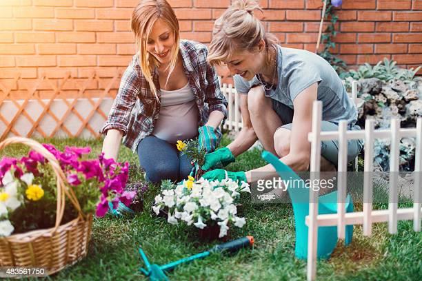 Lesbian Couple Planting Flowers