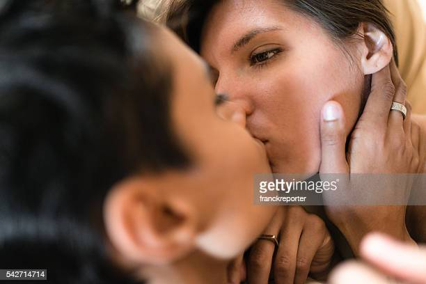 lesbian couple share the kiss on the bed