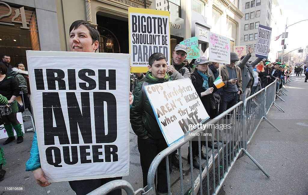 Lesbian gay bisexual and transgender activists protest the participation of NYPD members during the 250th annual St Patrick's Day parade March 17...