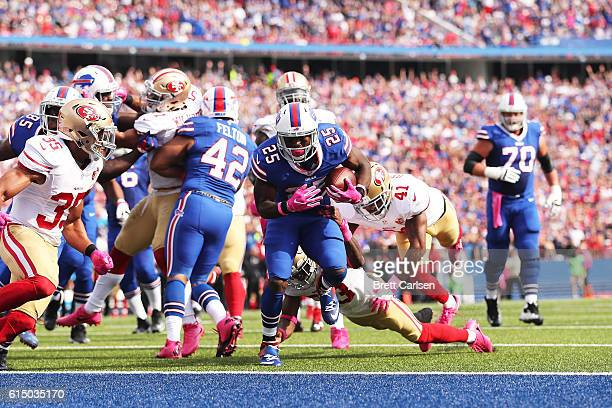 LeSean McCoy of the Buffalo Bills breaks a tackle by Rashard Robinson of the San Francisco 49ers for a touchdown during the first half at New Era...