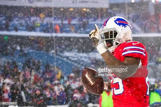 LeSean McCoy of the Buffalo Bills celebrates after scoring the game winning touchdown in overtime against the Indianapolis Colts at New Era Field on...