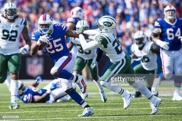 LeSean McCoy of the Buffalo Bills delivers a stiff arm on Marcus Maye of the New York Jets during the game on September 10 2017 at New Era Field in...
