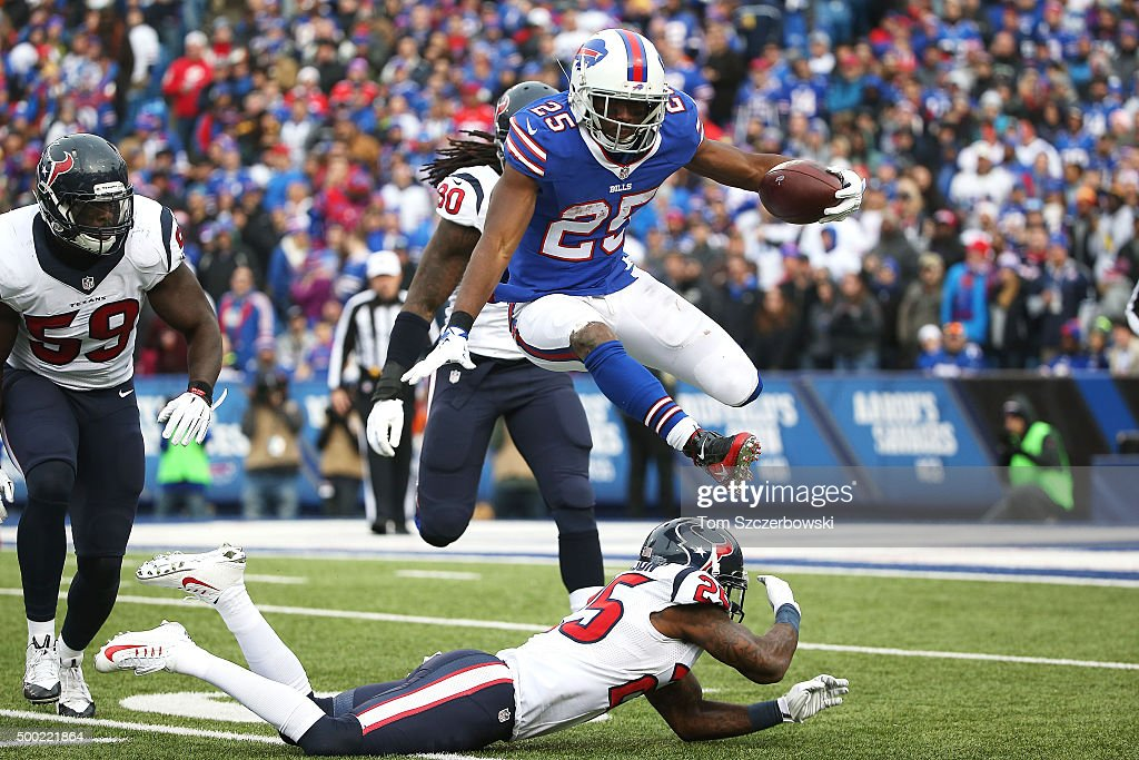 LeSean McCoy #25 of the Buffalo Bills hurdles Kareem Jackson #25 of the Houston Texans during the second half at Ralph Wilson Stadium on December 6, 2015 in Orchard Park, New York.