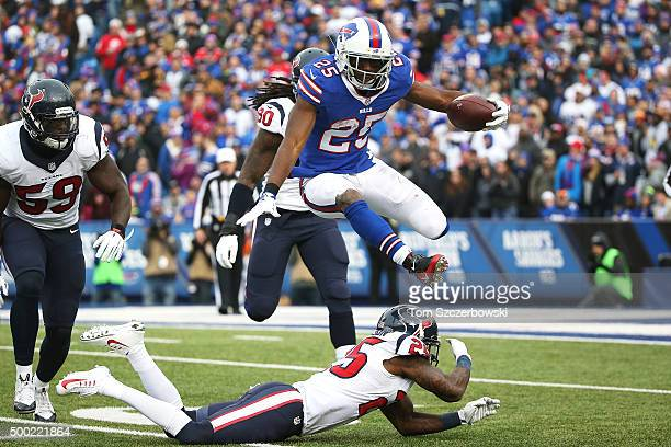 LeSean McCoy of the Buffalo Bills hurdles Kareem Jackson of the Houston Texans during the second half at Ralph Wilson Stadium on December 6 2015 in...