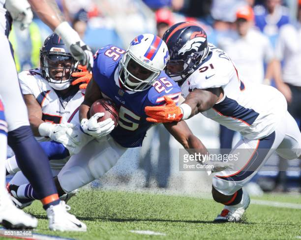 LeSean McCoy of the Buffalo Bills is tackled by Brandon Marshall and Todd Davis both of the Denver Broncos during an NFL game on September 24 2017 at...