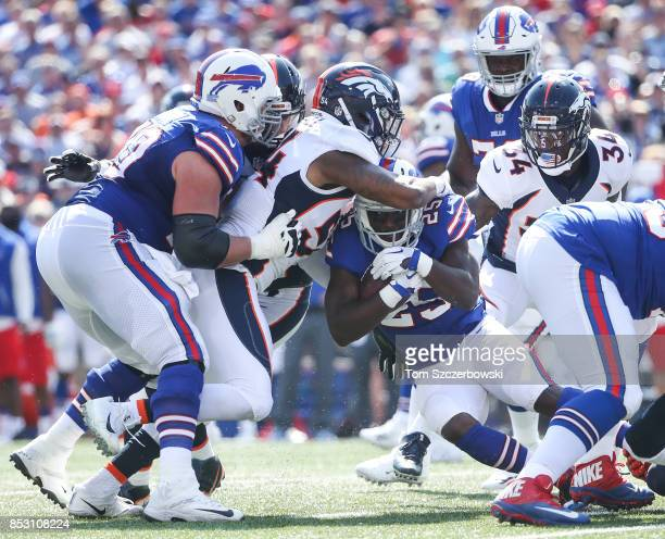 LeSean McCoy of the Buffalo Bills is tackled by Brandon Marshall of the Denver Broncos during an NFL game on September 24 2017 at New Era Field in...