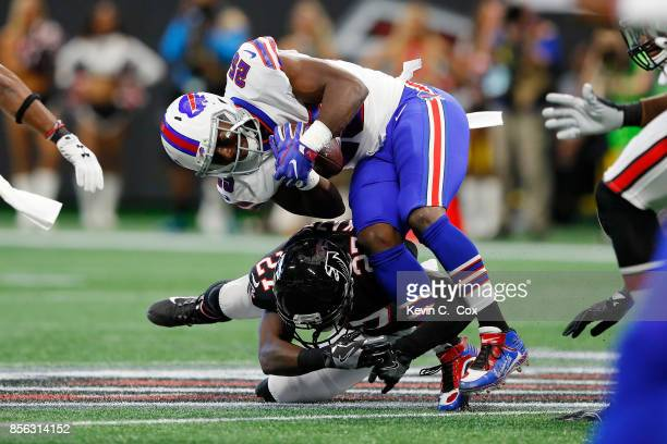 LeSean McCoy of the Buffalo Bills is tackled by Damontae Kazee of the Atlanta Falcons during the first half at MercedesBenz Stadium on October 1 2017...